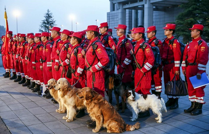 Members of Chinese International Search and Rescue Team and their rescue dogs gather before boarding a charted plane to Kathmandu, after a 7.9 magnitude earthquake hit Nepal, at Beijing Capital International Airport, China, April 26, 2015