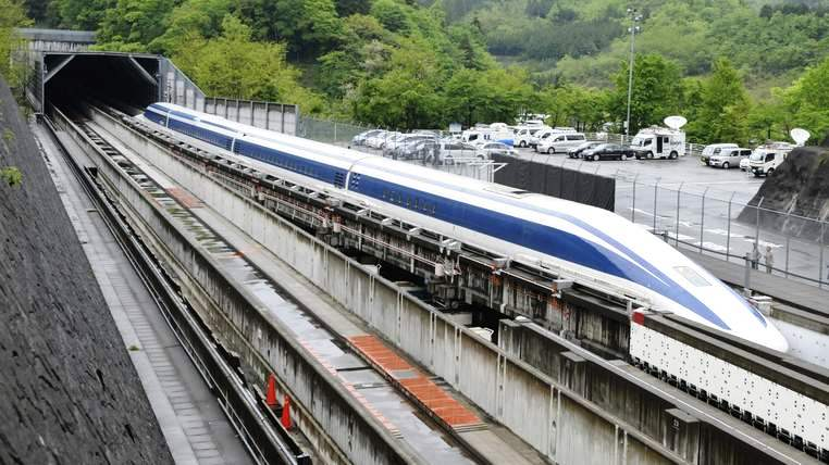"The Maglev (magnetic levitation) train speeds during a test run on the experimental track in Tsuru, 100km west of Tokyo, on May 11, 2010. US Transportation Secretary Ray LaHood took a test ride on Japan's super-fast magnetic train, a contender for President Barack Obama's multi-billion-dollar national railway project. Japan is up against China, France, Germany and other bidders as it seeks to sell its ""Shinkansen"" bullet and magnetic trains for the 13-billion-USD US high-speed national rail grid. AFP PHOTO/Toru YAMANAKA (Photo credit should read TORU YAMANAKA/AFP/Getty Images)"