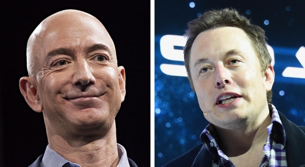 Amazon.com founder and CEO Jeff Bezos, left, and SpaceX CEO Elon Musk. (Getty Images)