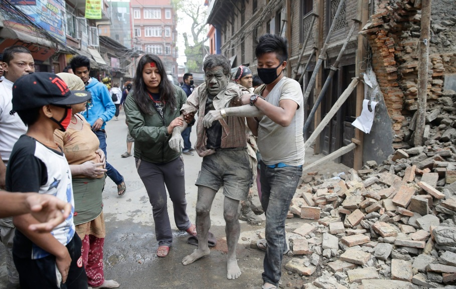 People free a man from the rubble of a destroyed building Photograph: Narendra Shrestha/EPA