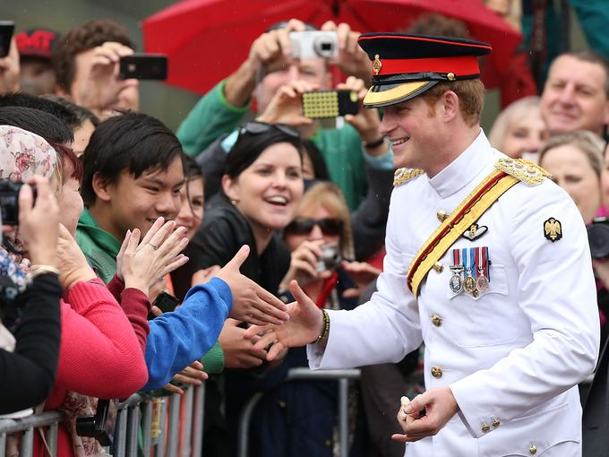 Prince Harry visits with members of the public outside the Australian War Memorial on April 6, in Canberra, Australia. Photo: Stefan Postles, Getty Images