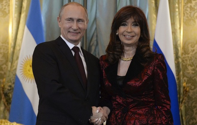 Russian President Vladimir Putin shakes hands with Argentina's President Cristina Fernandez during their meeting at the Kremlin in Moscow. Photo: Alexander Nemenov/ euters
