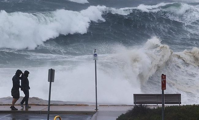 Large swells batter the coastline at Clovelly beach. Photo: Brett Costello