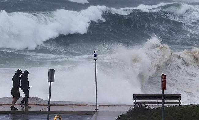 Large swells batter the coastline at Clovelly beach. Photo: Brett Costello