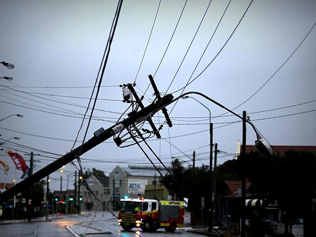 This power pole on the Princess Highway in Sydenham is one of many to come down in the wind. Photo: John Grainger