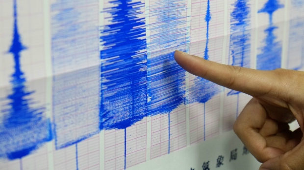 An employee of the Taiwan Central Weather Bureau points at the seismic chart showing the moment an earthquake that struck off the island's eastern coast in Taipei, Taiwan on April 20, 2015. (AP / Wally Santana)