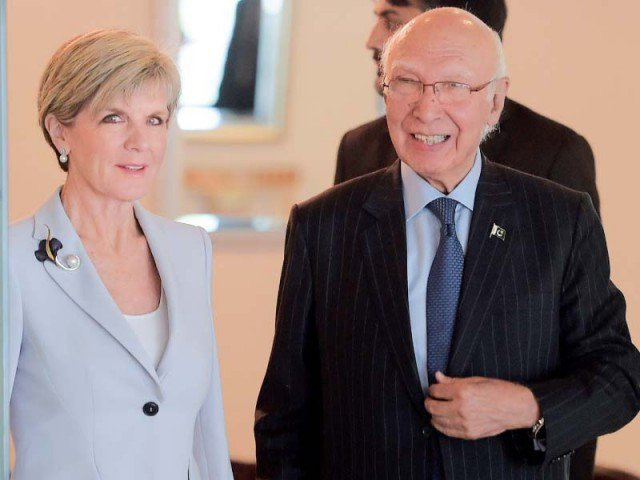 Australian Minister for Foreign Affairs Julie Bishop arrives at the Foreign Ministry with Prime Minister's Adviser on National Security and Foreign Affairs Mr. Sartaj Aziz