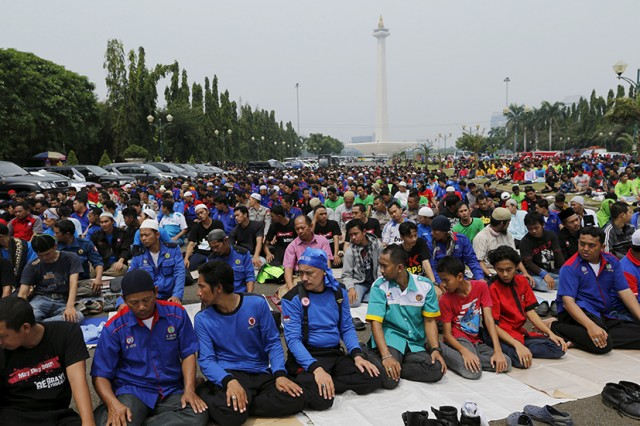 People gather in mass Friday prayer during a May Day rally in Jakarta, Indonesia, May 1, 2015