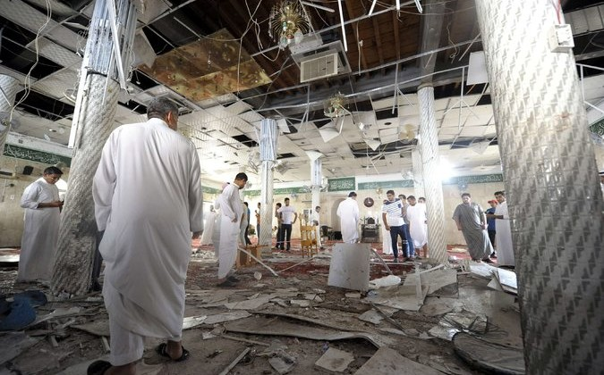 Saudi men inspected damage after a suicide bombing inside a mosque in Qatif, Saudi Arabia, on Friday. Photo: AFP — Getty Images