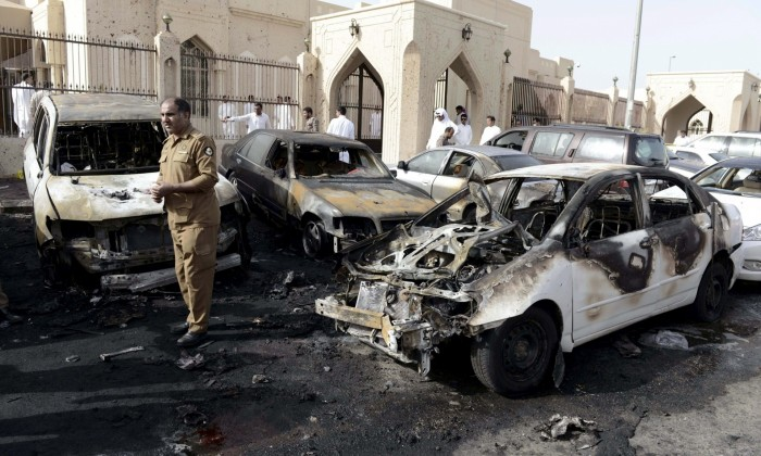 A policeman carries out an inspection after the explosion at the al-Anoud mosque. Photograph: Faisal al-Nasser /Reuters