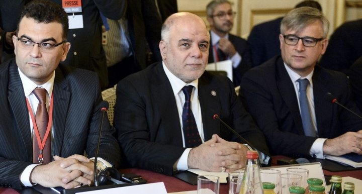 Iraqi Prime Minister Haydar al-Abadi, center, and members of the anti-Islamic State coalition meet in Paris, France, to discuss strategy in fighting the jihadists who have made key battlefield advances in recent weeks in Iraq and Syria, Tuesday, June 2, 2015.