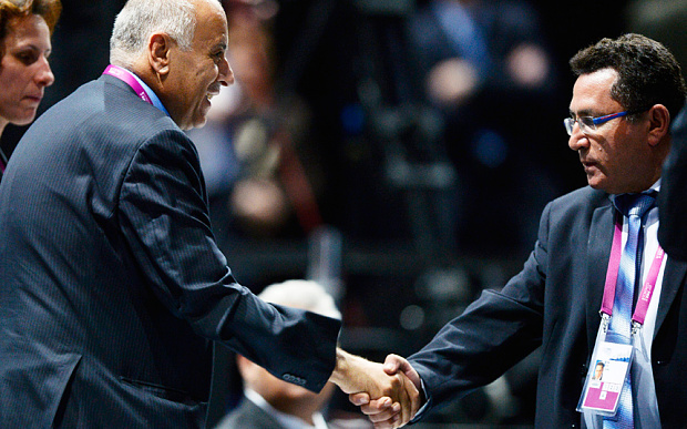 Jibril Rajoub shakes hands with Israeli soccer federation president, Ofer Eini