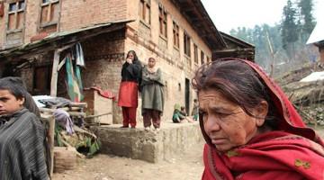 Roshni Jan, widow of Juma Khan, 38, outside her home. Image by Talal N. Ansari.