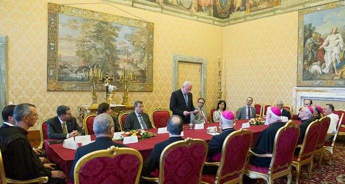 Palestinian Foreign Minister Riad al-Malki, standing, at a treaty-signing ceremony at the Vatican on Friday. Photo credit: L'Ossservatore Romano via AP