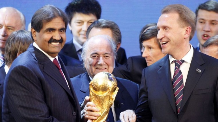 Officials from Qatar (left) and Russia (right) celebrate being awarded the right to host the World Cup