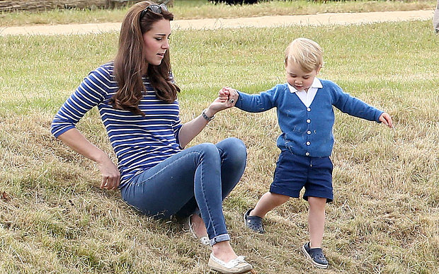 Catherine Duchess of Cambridge in a pair of skinny jeans, with her son Prince George.