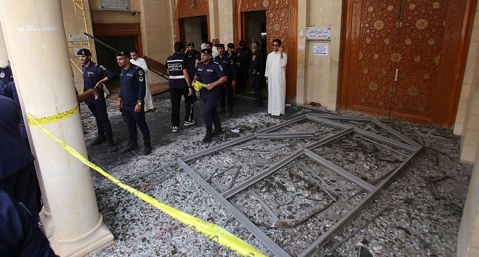 Kuwaiti security forces gather outside the Shiite Al-Imam al-Sadeq mosque after it was targeted by a suicide bombing during Friday prayers on June 26, 2015, in Kuwait City. Photo: Yasser Al-Zayyat/AFP via Getty Images