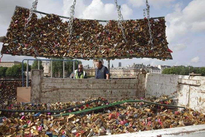 City workers pile padlocks into a truck after being removed from the Pont des Arts in Paris. (Reuters: Philippe Wojazer)