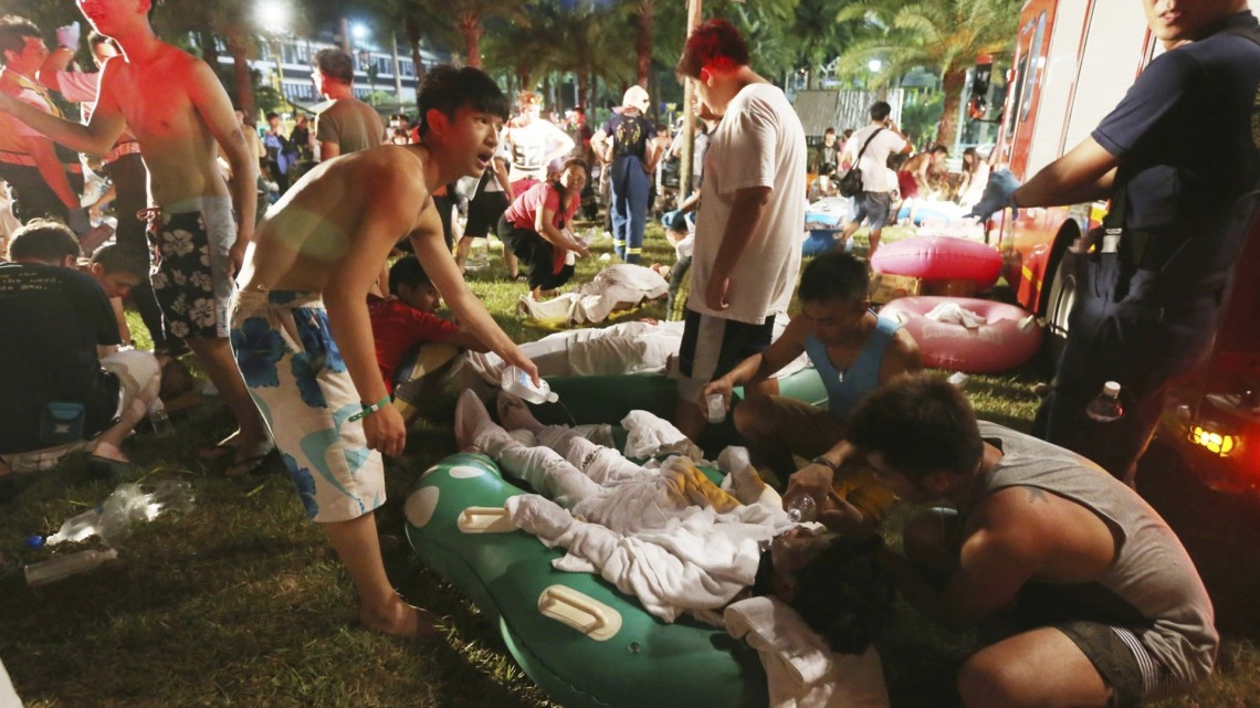 Emergency workers and partygoers tend to the injured at the Formosa Water Park. Photograph: AP