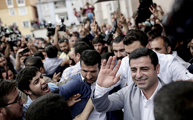Selahattin Demirtas, right, co-chair of the Peoples' Democratic Party (HDP) at a polling station in Istanbul (AFP)