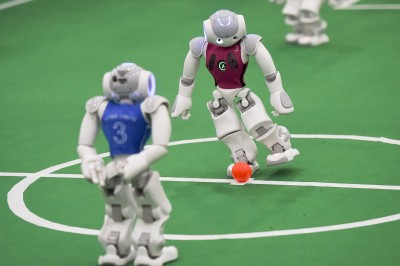 Little robots compete for the 2015 RoboCup in tiny soccer match. Photo: ZHANG DUAN/XINHUA PRESS/CORBIS