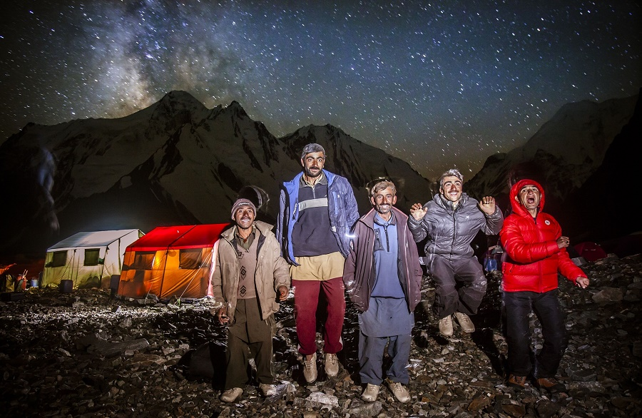 The porters photographed outside at base camp. They sometimes light fires using rubbish from the expeditions. PHOTO: DAVID KASZLIKOWSKI