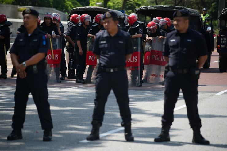 Malaysian police have launched a series of raids across the country against suspected ISIS militants, detaining 10 individuals. Above, Malaysian police take position outside the federal court ahead of a controversial ruling in Putrajaya, outside Kuala Lumpur, Feb. 10, 2015. Mohd Rasfan/AFP/Getty Images