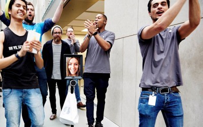The face of Australian woman Lucy Kelly appearing on an iPad attached to a Segway-style device as she became one of the first people to buy one of the latest iPhones at the Apple store in Sydney. Photo: AFP