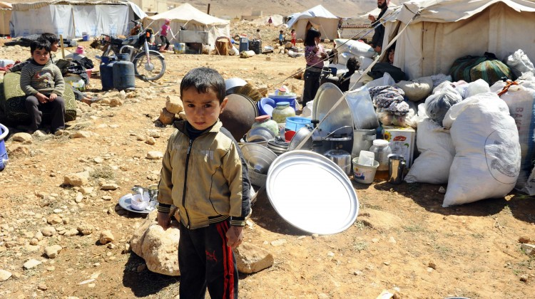 A Syrian refugee child who fled the violence from the Syrian town of Flita, near Yabroud, poses for a photograph at the border town of Arsal in Bekaa Valley, Lebanon situated along the border with Syria