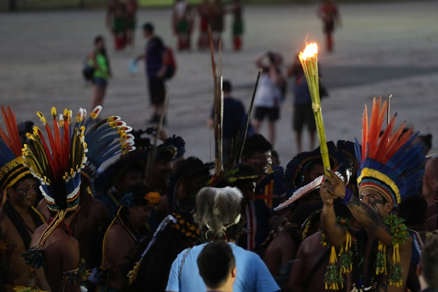 Manoti Indians light up a torch with the sacred fire of the World Indigenous Games in Palmas, Brazil, Thursday, Oct. 22, 2015. (AP Photo/Eraldo Peres)