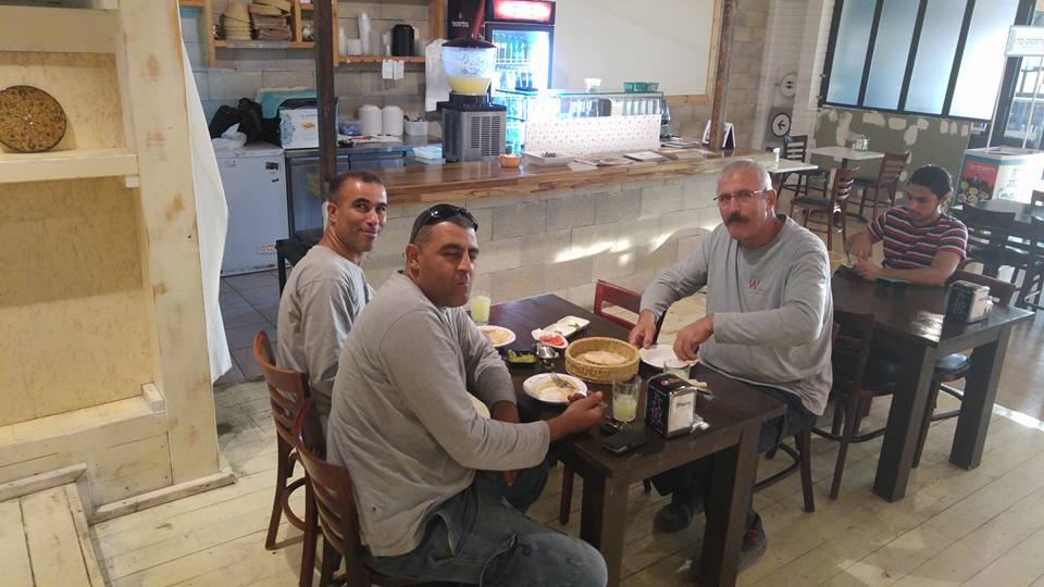 Muslims and Jews sharing meal together in Hummus cafe in Israel.