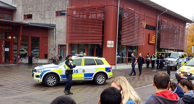 Police outside the school in Trollhattan. Photo: EPA