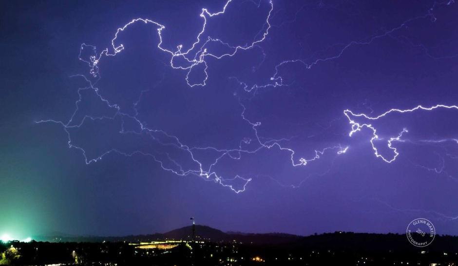"Lightning strikes ""like silly string"" over Parliament House. Photo: Glenn Martin"