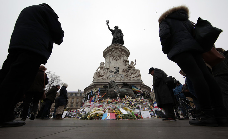 People pay tribute to the victims of Paris attacks at the Place de la Republique in Paris, France, November 27, 2015. Photo: Eric Gaillard Reuters