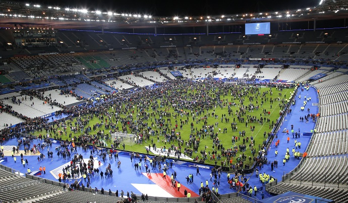 Spectators invade the pitch of the Stade de France stadium after the friendly soccer game between France and Germany, Friday, November 13, 2015, in Saint Denis, outside Paris. AP Photo/Michel Euler