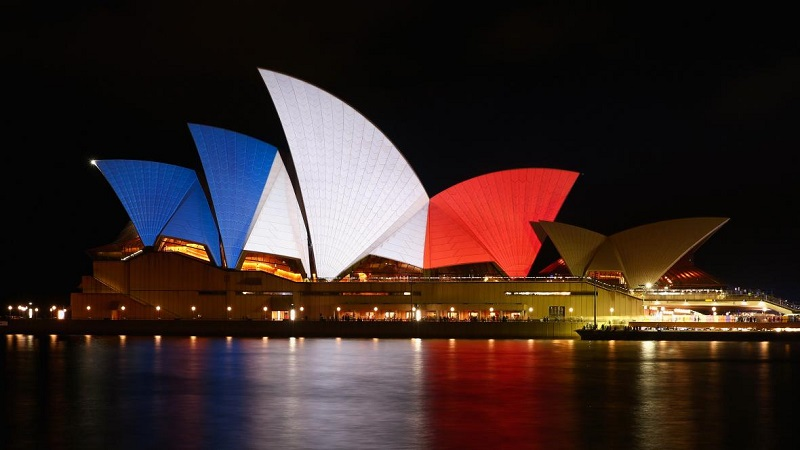 "The ""sails"" of the Sydney Opera House are illuminated in the colors of the French flag on Saturday, Nov. 14, 2015 in Sydney, Australia. At least 120 people have been killed and over 200 are injured in Paris following a series of terrorist acts in the French capital on Friday night."