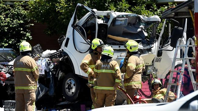 Firefighters at the crash scene on the corner of Barkly and Gordon streets. Photo Source:News Corp Australia