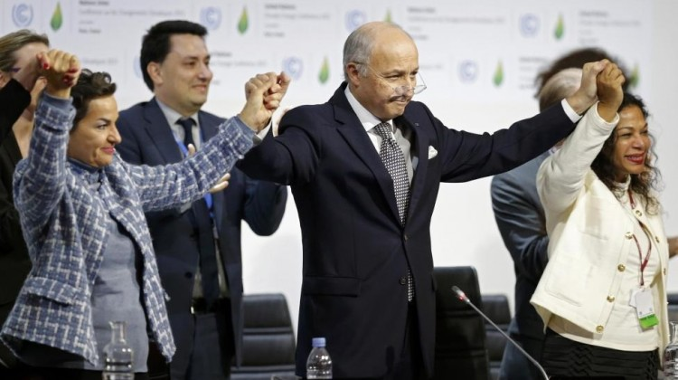 French Foreign Affairs Minister Laurent Fabius (C), President-designate of COP21 and Christiana Figueres (L), Executive Secretary of the UN Framework Convention on Climate Change, hold hands as they react during the final plenary session at the World Climate Change Conference 2015 (COP21) at Le Bourget, near Paris, France, December 12, 2015. REUTERS/Stephane Mahe
