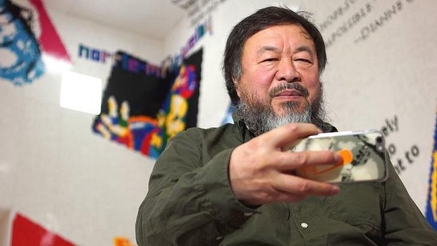 Ai Weiwei takes a selfie in the Lego installation at the National Gallery of Victoria. Photo: Tom McKendrick