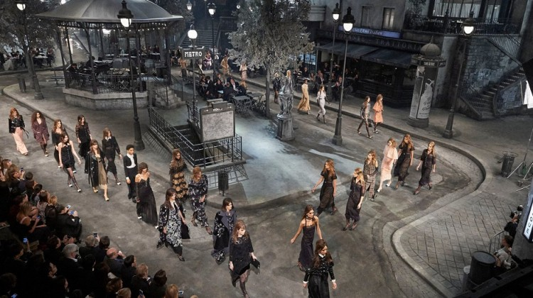 Rome's Cinecittà film studio became a bohemian portion of Paris for the evening as models bypassed guests sat on bistro chairs on a makeshift Parisian pavement