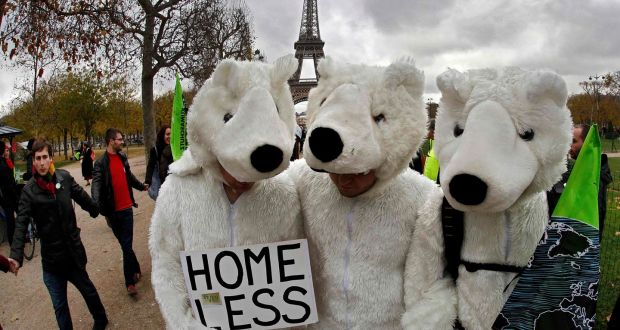 hree environmentalists wear polar bear costumes as they take part in a demonstration near the Eiffel Tower in Paris, France, as the World Climate Change Conference 2015 (COP21) on Saturday. Photograph: Reuters