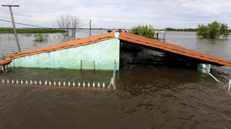 A flooded home is pictured in Asuncion, Paraguay. Photo Source: Reuters/Jorge Adorno