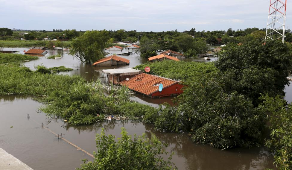 Houses are seen partially submerged in floodwaters in Asuncion, Paraguay. Photo Source: Reuters
