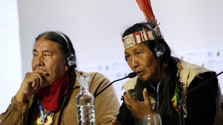 Protecting forests can mitigate the effects of worldwide climate change, indigenous leaders Tom B.K. Goldtooth of Bemjdji, Minnesota, left, and Gloria Hilda Ushiqua-Santi of the Ecuadorian Amazon rainforest stress at the United Nations Climate Change Conference in LeBourget, France, Tuesday. The conference continues until next week. (Photo: AP)