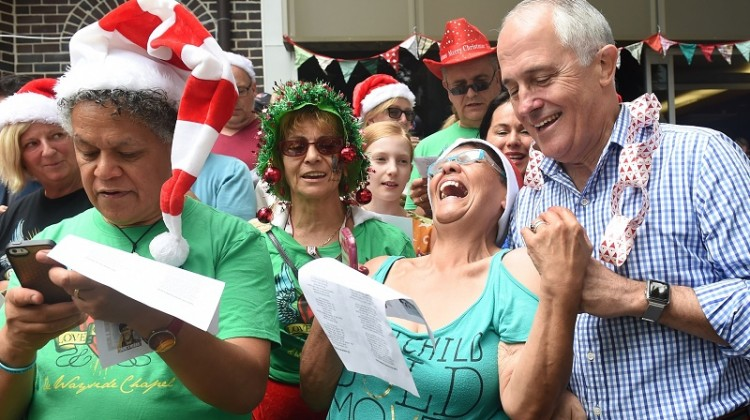 Malcolm Turnbull sings with a choir at the Wayside Chapel Christmas Day street party. Photo: Paul Miller/AAP