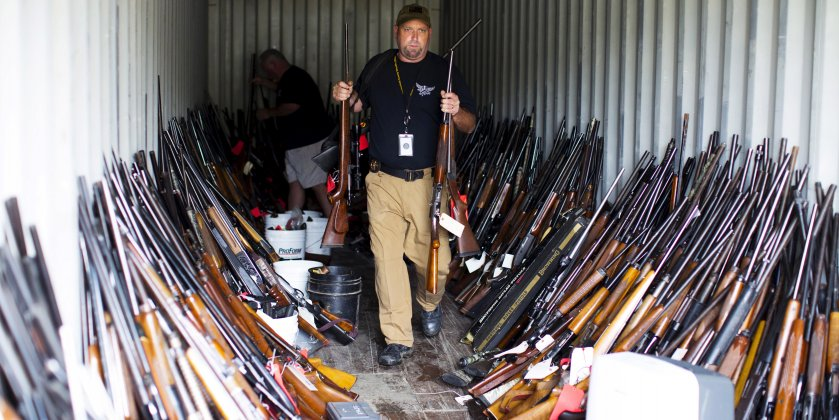 guns ammunition gun control firearms Chesterfield County Sheriff's lieutenant David Lee removes rifles from a shipping container as he and other officers sort through thousands of guns found in the home and garage of Brent Nicholson, in Pageland, South Carolina, November 10, 2015. Photo: REUTERS/Jason Miczek