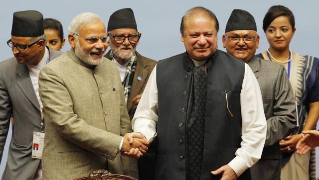 Prime Minister Narendra Modi shakes hands with his Pakistani counterpart Nawaz Sharif at the 18th SAARC Summit in Kathmandu, Nepal. (AFP)