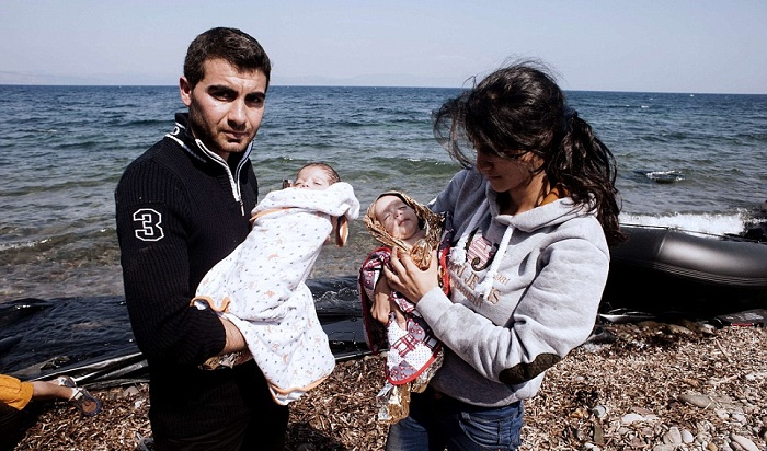 A refugee couple with their babies after safely reaching Greece