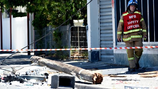 A power pole lies on its side after the explosion. Photo Source:News Corp Australia