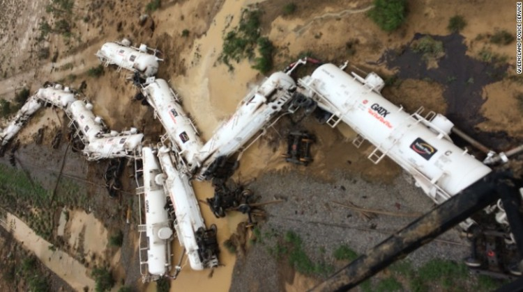 The freight train was carrying sulfuric acid when it derails in northern Queensland.